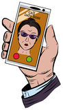 The hand holds the phone with an incoming call from the chief of the woman Stock Image
