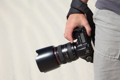 Hand holds photo camera Royalty Free Stock Photography