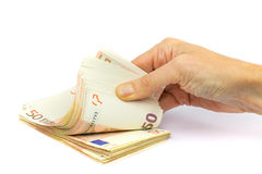 Hand holds pile of fifty euro bills on white background Royalty Free Stock Photography