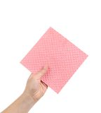 Hand holds pink cleaning sponge. Royalty Free Stock Photography