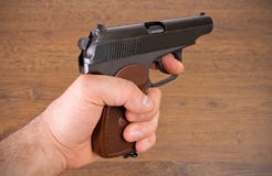 Hand holds a pistol Stock Photo