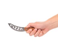 Hand holds pizza's knife. Royalty Free Stock Photos