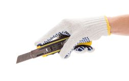 Hand holds plastic Craft Knife Stock Image