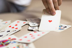 The hand holds a playing card. Card game Royalty Free Stock Photo