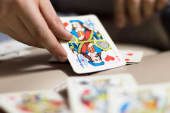 The hand holds a playing card. Card game Stock Photography
