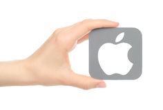 Hand holds popular operating system logo. Kiev, Ukraine - May 18, 2016: Hand holds popular operating system logo printed on paper Apple ios. Apple Inc. is an royalty free stock images