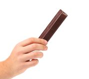 Hand holds porous milk chocolate. Stock Photography