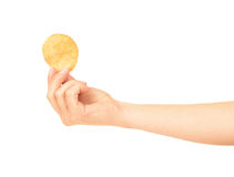 Hand holds potato chips. Stock Images