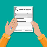 Hand holds prescription rx form and pills Royalty Free Stock Image