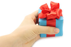 Hand holds present box Stock Photography