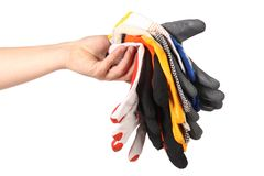 Hand holds protective different gloves. Hand holds some different gloves. Close up stock images