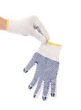 Hand holds protective gloves with blue circles. Stock Photo