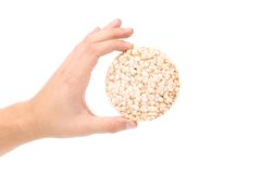 Hand holds puffed wheat bread. Royalty Free Stock Images