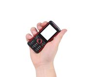 Hand holds red-black cell phone. Isolated on a white background Stock Photos