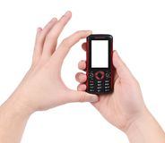 Hand holds red-black cell phone. Isolated on a white background Royalty Free Stock Photos