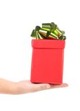 Hand holds red box with bow. Stock Photo