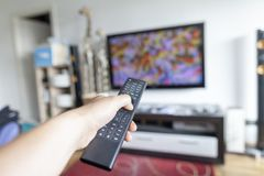 Hand holds a remote control Royalty Free Stock Images
