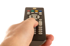 Hand holds the remote control tv Stock Photo