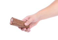 Hand holds roll of chocolate ice cream. Stock Images