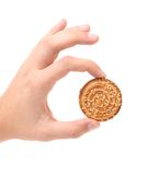 Hand holds round cookies. Royalty Free Stock Photo