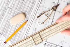 Hand holds the ruler to create a drawing Stock Image