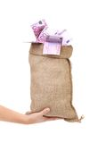 Hand holds sack with euro bills. Royalty Free Stock Photography
