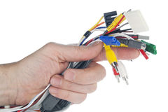 Hand holds set of cables with connectors. Hand holds set of cables with digital connectors isolated on white. Selective focus stock photography