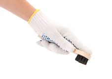 Hand holds shoes brush. Royalty Free Stock Image
