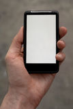 Hand Holds a Smart Phone. With a blank screen Royalty Free Stock Photo