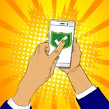 Hand holds smart phone with green shield and a finger touches the screen. royalty free illustration
