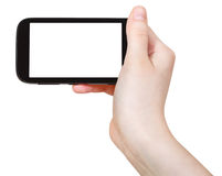 Hand holds smart phone isolated Royalty Free Stock Photos