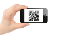 Hand holds smart phone with QR code Stock Image