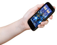 Hand holds smart phone with Xmas still life Stock Photography