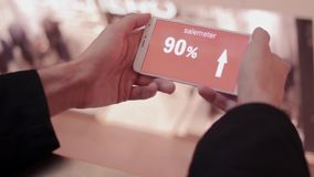 Hand holds smartphone, discounts on screen. Shopping mall black friday, sales. People on background stock video footage