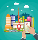 Hand holds smartphone with navigation app. Hand holds smartphone or tablet pc with navigation app against cityscape in day. Navigation concept. Flat design Stock Photos