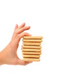 Hand holds stake saltine soda cracker. Royalty Free Stock Photos