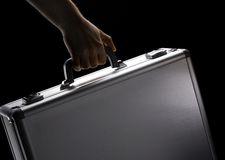 Hand holds suitcase Royalty Free Stock Images