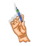 Hand holds the syringe with the vaccine. Stock Image
