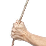 Hand holds a thick rope. Stock Images