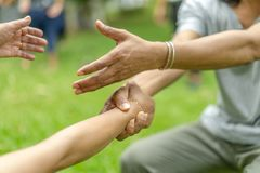 Hand holds together in the community in the garden / park royalty free stock photos