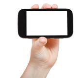 Hand holds touchscreen phone isolated Royalty Free Stock Images