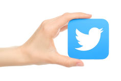 Hand holds twitter icon Stock Photos