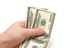 Hand holds two 100 dollars bills Royalty Free Stock Photo
