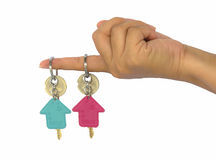 Hand holds two key of the house. Isolated on white background Royalty Free Stock Photo