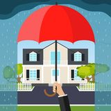The hand holds an umbrella over the house. The concept of home security. Flat design,  illustration Stock Image