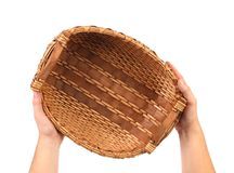 Hand holds vintage weave wicker basket Stock Images
