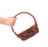 Hand holds vintage weave wicker basket Royalty Free Stock Images