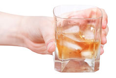 Hand holds whiskey on ice in glass isolated Stock Image