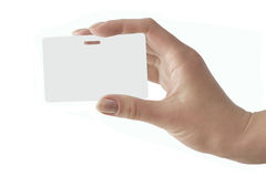 Hand holds a white badge Stock Images