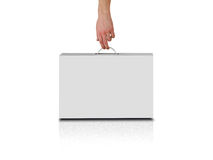 Hand holds a white box with a handle. Packing box for laptop. Isolated on white background Stock Photography